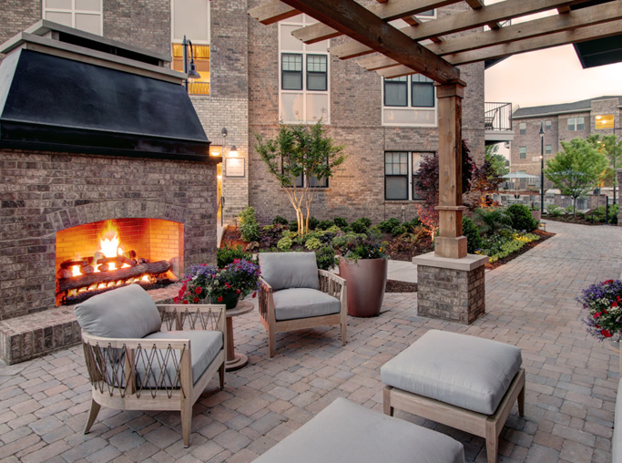 Cadence Cool Springs apartments for rent in Cool Springs - Resident outdoor lounge with fireplace