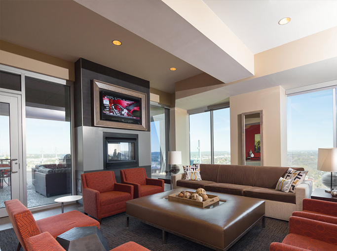 SkyHouse Houston Indoor lounge with ample seating and fireplace - Houston Medical Center TX