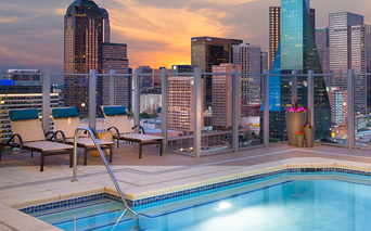 SkyHouse Dallas - Rooftop pool lounge with downtown views - Uptown Dallas Apartments