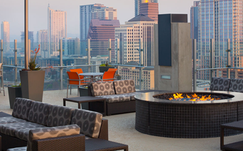 SkyHouse Austin poolside terrace with outdoor TV's and fireplace Austin TX - Rainey Street
