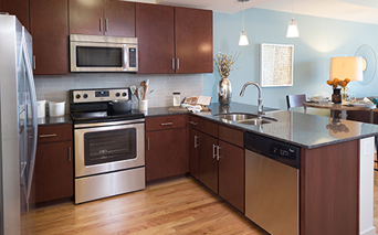 SkyHouse Houston Kitchen with stainless steel appliances - Highrise Downtown Houston TX