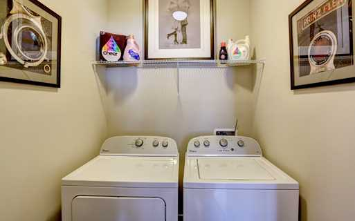 Apartments with Gwinnett County Public Schools - Artisan Station Apartments Washer and Dryer