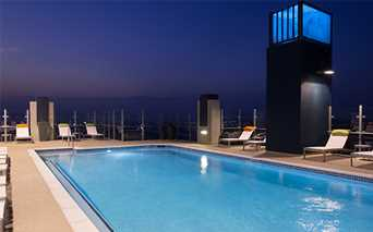 SkyHouse Houston Rooftop pool lounge with sweeping downtown views - Downtown Houston TX