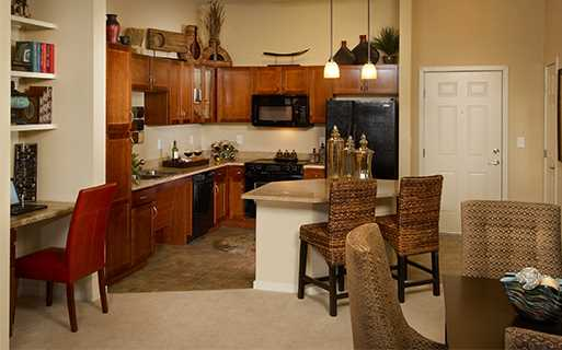 Apartments near Saddle Rock Golf Course - The Sanctuary At Tallyn's Reach Kitchen with granite countertops and kitchen islands