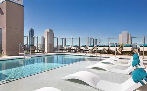 Houston high rise apartments for rent - SkyHouse River Oaks Two rooftop swimming pools