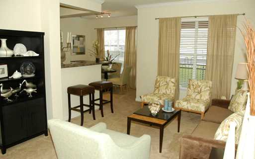 Reserve At Beachline Living room interior model Orlando FL - Airport