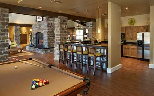 Aurora apartments near Centennial Airport - Coyote Ranch Clubhouse with billiards and Wi-fi