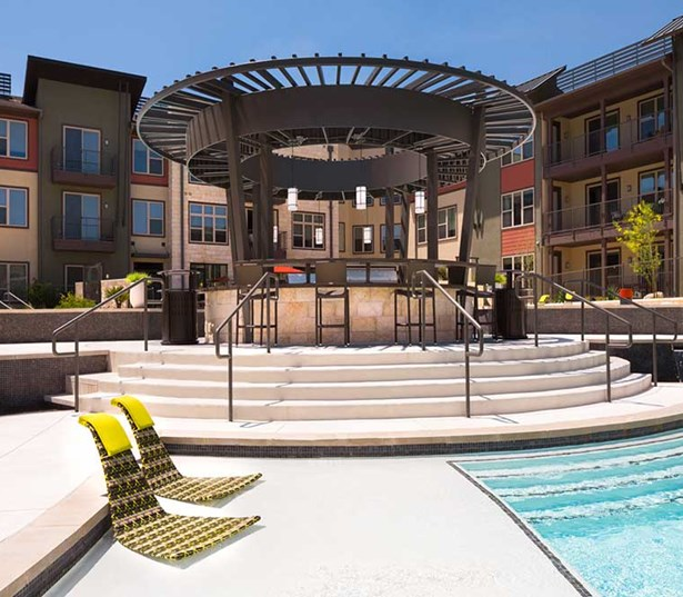 Austin Domain apartments - Addison at Kramer Station Outdoor Lounge with TV and Fire Pit