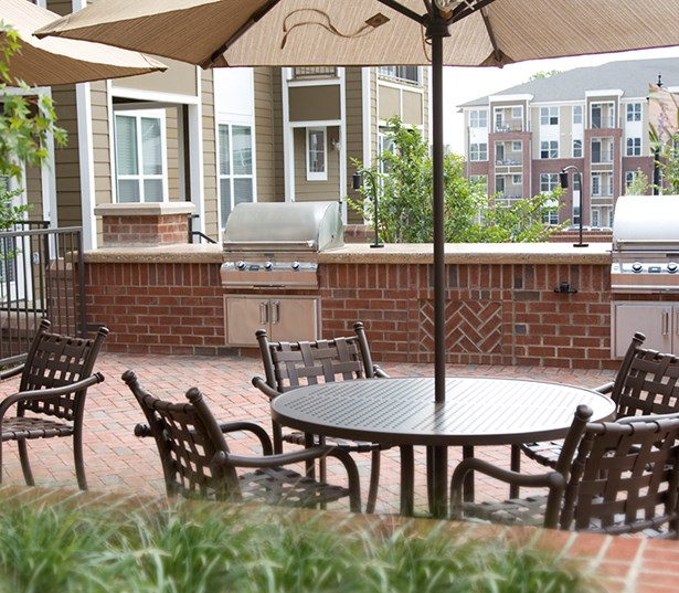 Gramercy Square At Ayrsley Two gas grills and dining areas poolside Charlotte NC - Steel Creek