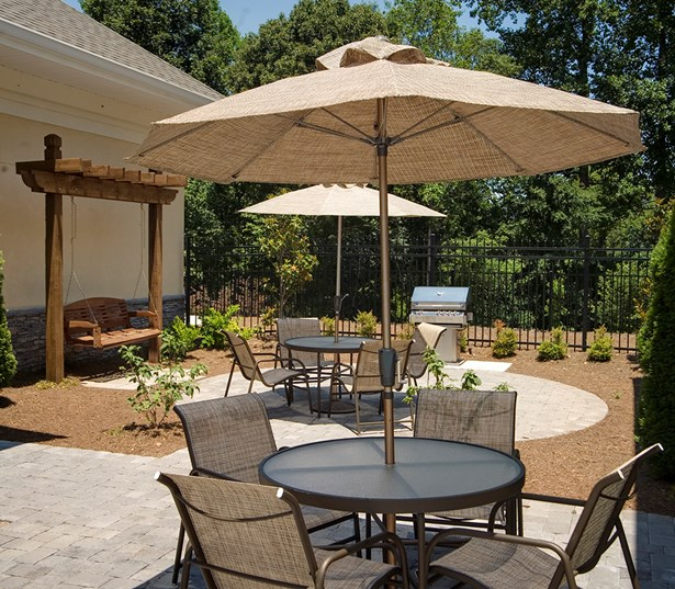 Berkeley Hills Country Club apartments in Johns Creek - Menlo Creek Poolside grills and tables