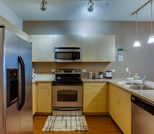 Apartments near OHSU - The Matisse kitchens with bamboo finish and granite countertops