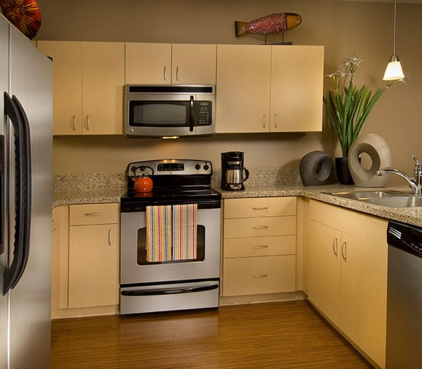 The Matisse refurbished kitchens with bamboo finish and granite countertops Portland OR - OHSU