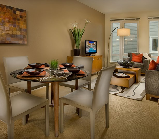 The Matisse Modern living/dining room with expansive windows Portland OR - Downtown Portland