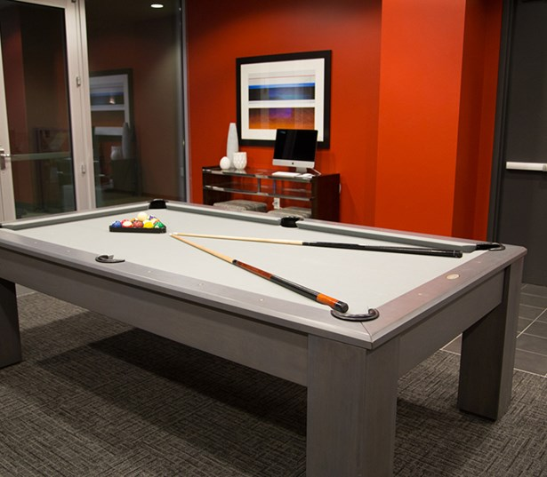 SkyHouse Houston Indoor clubroom with pool table - Highrise Downtown Houston TX