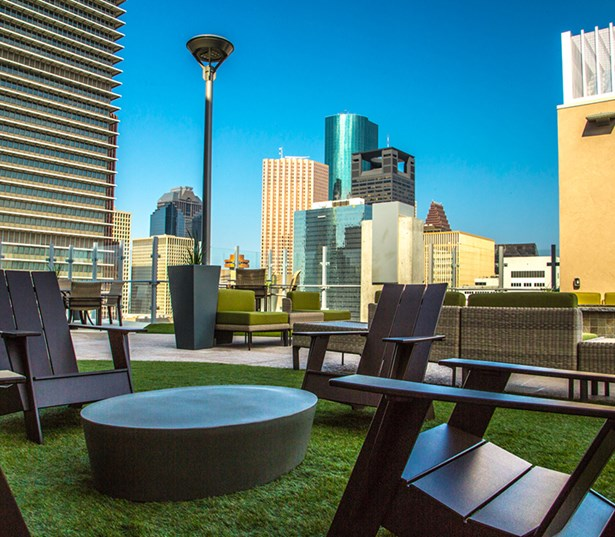 SkyHouse Main Rooftop lounge with downtown views - Downtown Houston TX