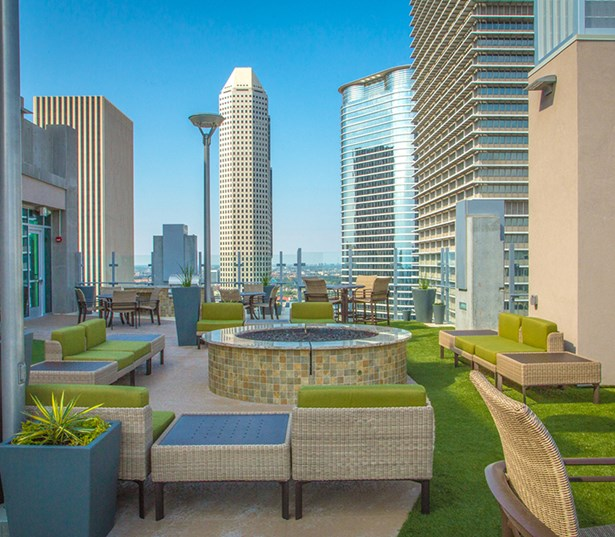 SkyHouse Houston Rooftop lounge with fireplace - Houston Medical Center TX