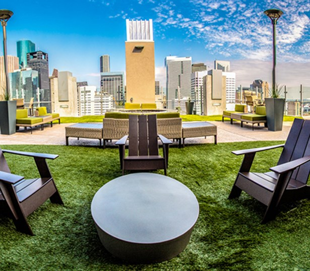 SkyHouse Houston Rooftop lounge with fireplace - Downtown Houston TX