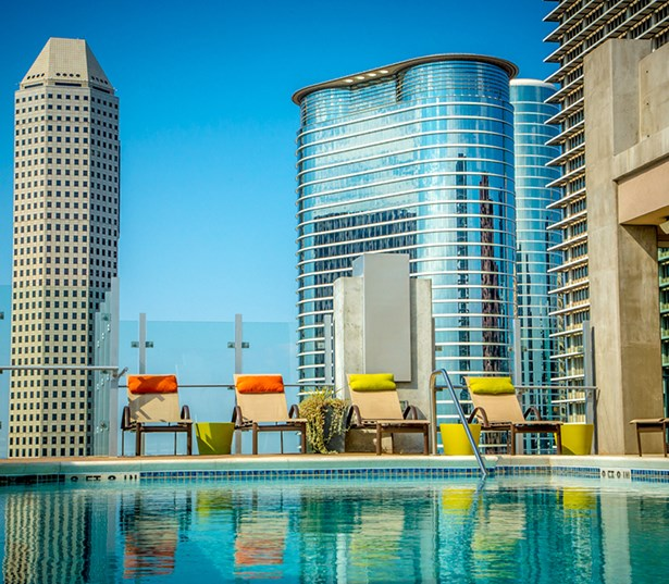 SkyHouse Houston Main Poolside terrace outdoor TV's and fireplace - Highrise Downtown Houston