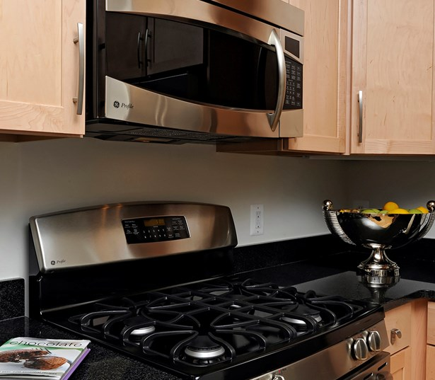 The Reserve At Tysons Corners Kitchen gas range and built in microwave Vienna VA - Mosaic District