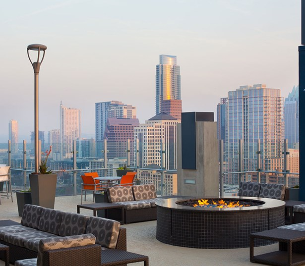 SkyHouse Austin Rooftop deck with firepit and views of downtown Austin TX - Rainey Street