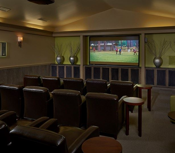 Apartments in the Cherry Creek School District - Coyote Ranch Theater with large screen HD screen