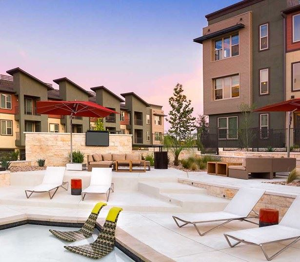 Addison at Kramer Station apartments for rent in Austin - Outdoor Kitchen with bar and lounge