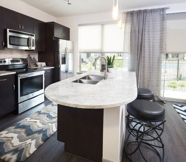 apartments near the domain austin tx - Addison at Kramer Station Kitchen with granite countertops