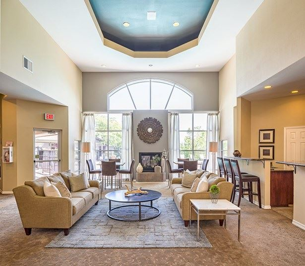 Victory Flats apartments in Cedar Hills - Clubhouse equipped with fireplace TV and ample seating