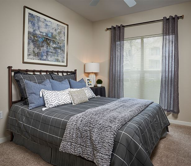 Apartments in the Cherry Creek School District - Coyote Ranch Master bedroom with ceiling fans