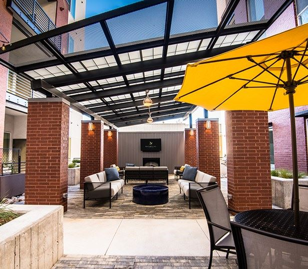 Hartley Flats Courtyard Lounge with TV Denver CO - RiNo