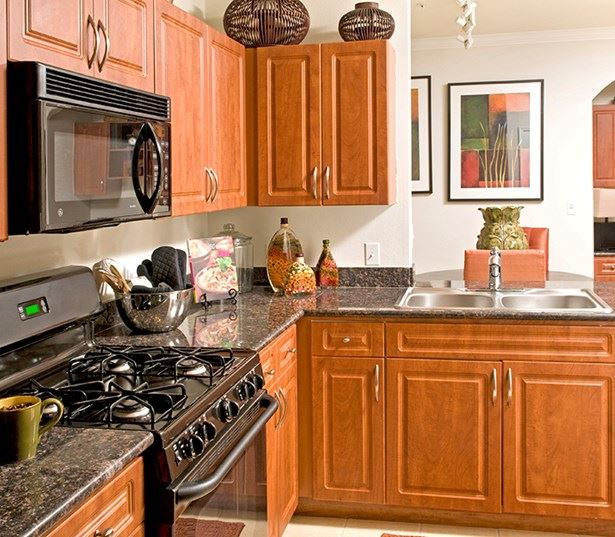 Highlands at Dearborn Kitchens sleek black appliances built in microwaves Peabody MA - West Peabody