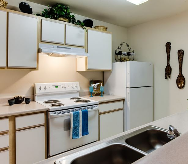 Quatama Crossing apartments near Liberty High School Fully equipped kitchens with dishwashers