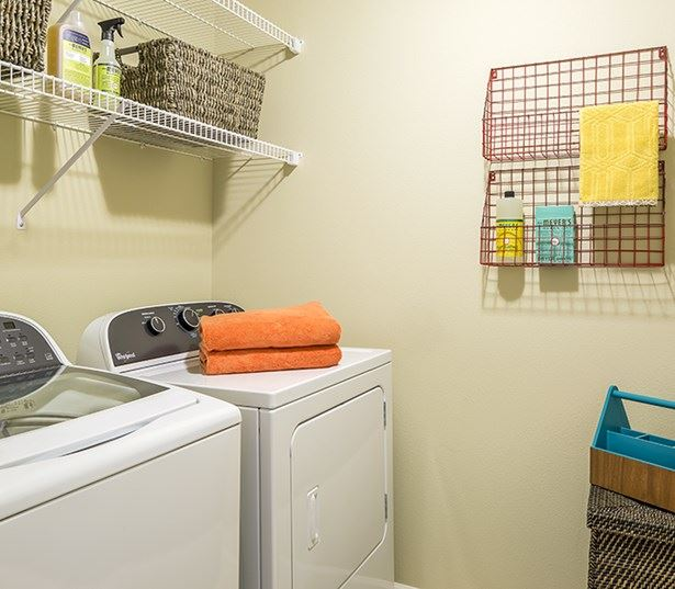 Victory Flats apartments in Beaverton - Large laundry room shelving and full size washer and dryer