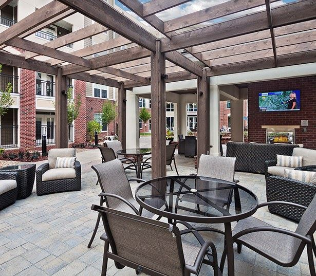 apartments near crabtree - Marshall Park Courtyard with pool side outdoor kitchen and TV Lounge