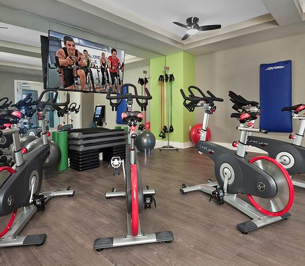 Marshall Park apartments 27612 - Fitness theater - virtual trainer spin bikes steps weights