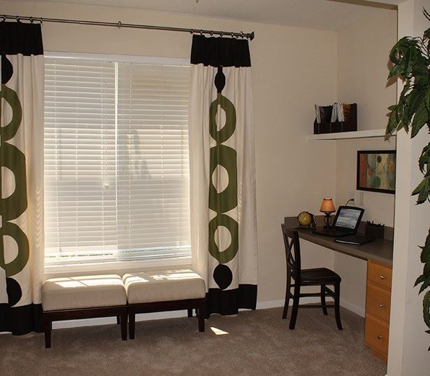 The Madison bright sun room with built in desk and shelving Richmond VA - Short Pump