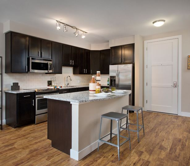 The Battery on Blake Street wood flooring - Apartments in Downtown Denver