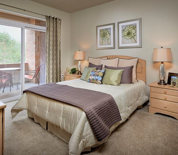Parker apartments for rent - The Meadows At Meridian Bedroom with attached patio and balcony