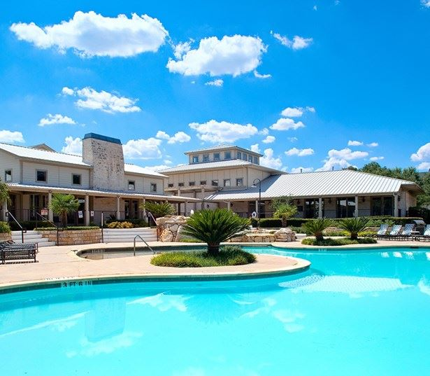 Round Rock ISD apartments - The Ranch Apartments Sparkling swimming pool with hot tub