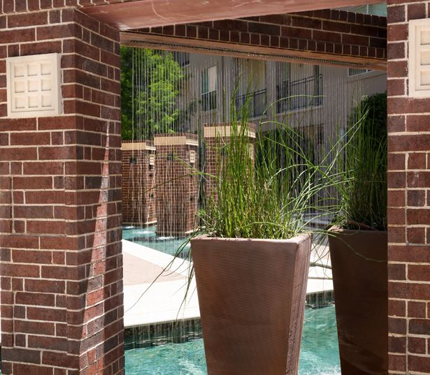 The Icon at Ross water features in courtyard - Uptown Dallas Apartments