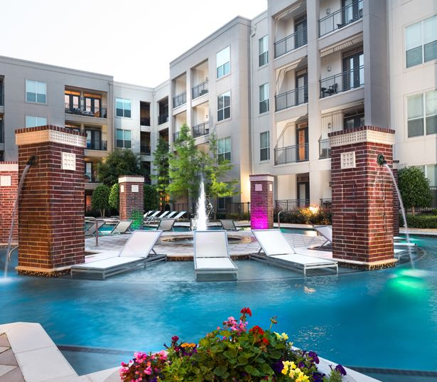 The Icon at Ross swimming pool with night pool lights - Uptown Dallas Apartments