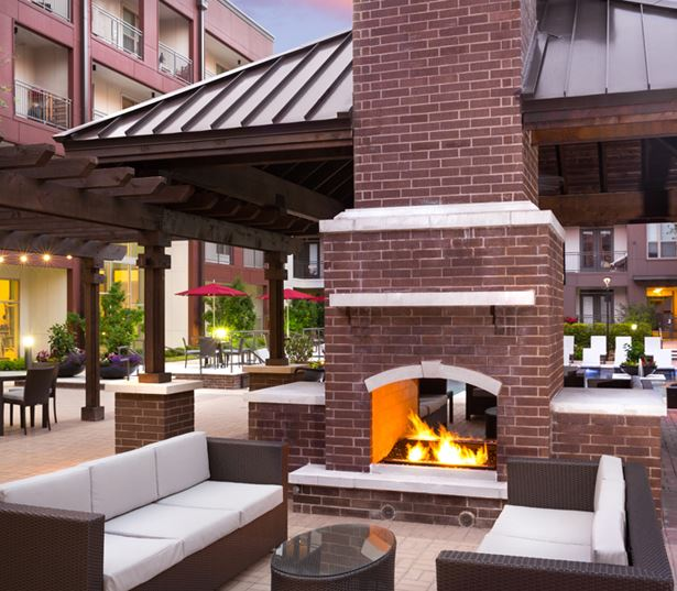 Strata Apartments - outoor lounge and fireplace - Knox-Henderson Apartments