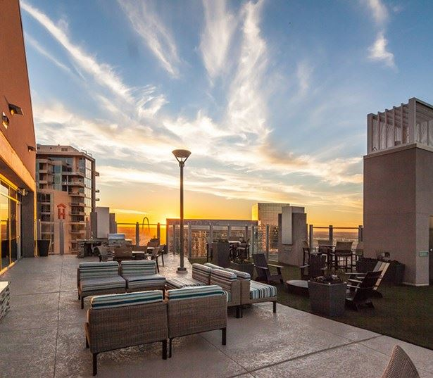 SkyHouse Dallas - Rooftop lounge and fireplace - Apartments in Trinity Groves