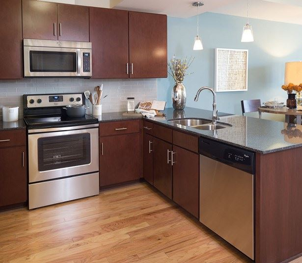 SkyHouse Austin apartments downtown - kitchens granite countertops stainless steel appliances