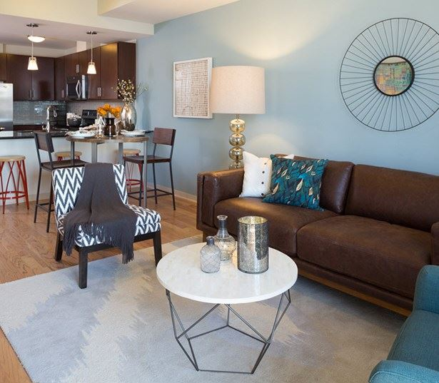 Downtown austin apartments - SkyHouse Austin Hardwood flooring in kitchen living and dining area