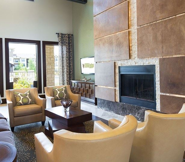 StoneLedge Apartments - Fireplace and sitting area - Grapevine ISD Apartments
