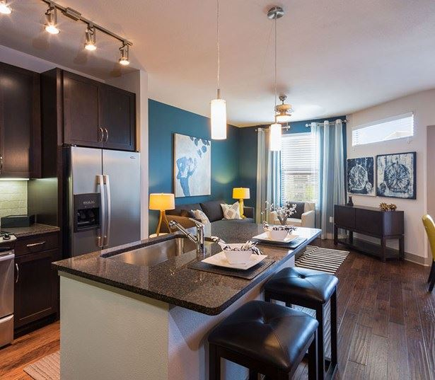 StoneLedge Apartments - Kitchen with granite countertops - Grapevine Lake Apartments