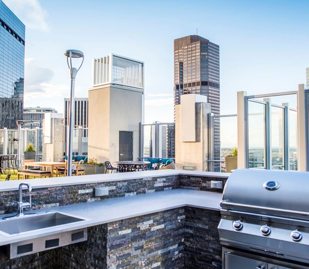 Downtown Denver apartments for rent in Uptown - SkyHouse Denver grills