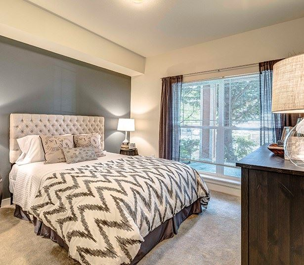 The Lodge at Redmond Ridge apartments near Aerotek - Model bedroom with large windows