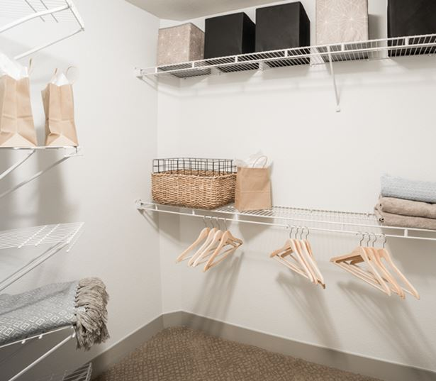 Expansive Walk In Closets With Built Shelving